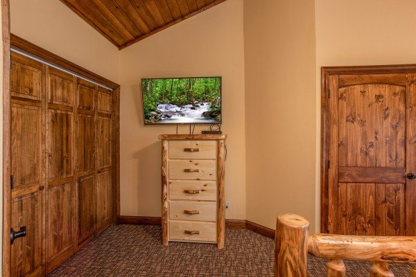Bedroom with a dresser and TV at Over Ober Lodge, a 5 bedroom cabin rental located in Gatlinburg