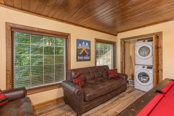 Sleeper sofa and laundry space at Over Ober Lodge, a 5 bedroom cabin rental located in Gatlinburg