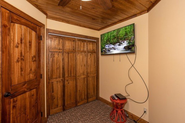 Bedroom with a closet and TV at Over Ober Lodge, a 5 bedroom cabin rental located in Gatlinburg