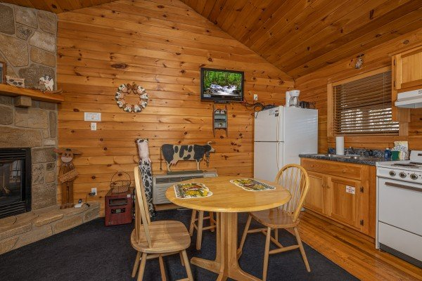 Kitchen and dining space at Country Getaway, a 1 bedroom cabin rental located in Pigeon Forge