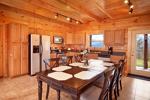 dining table with six chairs at looky yonder a 2 bedroom cabin rental located in gatlinburg