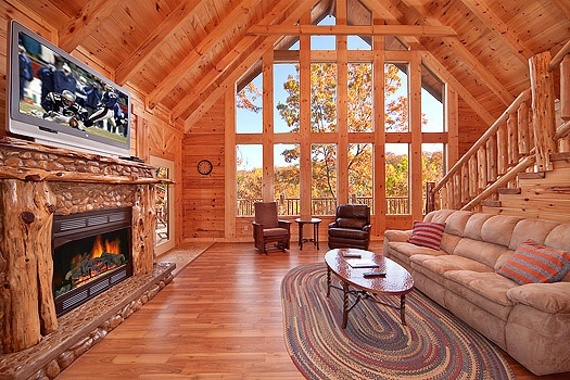 living room with stone fireplace at looky yonder a 2 bedroom cabin rental located in gatlinburg