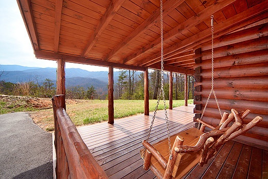 log swing on the deck at looky yonder a 2 bedroom cabin rental located in gatlinburg