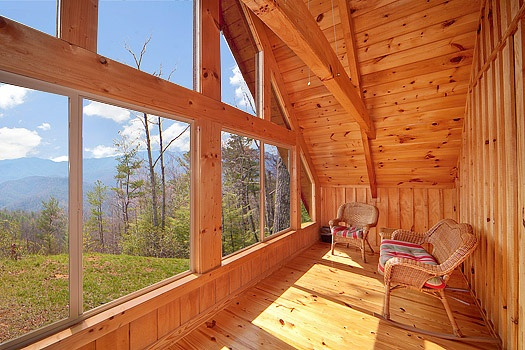 Sun room with Smoky Mountain views from Looky Yonder, a 2 bedroom cabin rental located in Gatlinburg