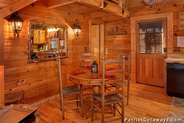 Dining space for four people in the kitchen at Elevation 1454, a 1-bedroom cabin rental located in Pigeon Forge