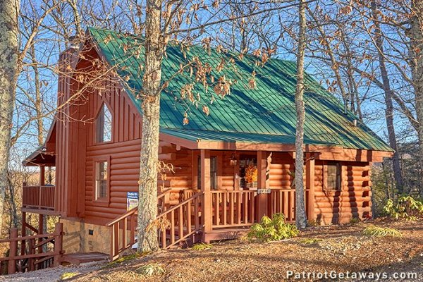Front exterior and walkway at Elevation 1454, a 1-bedroom cabin rental located in Pigeon Forge