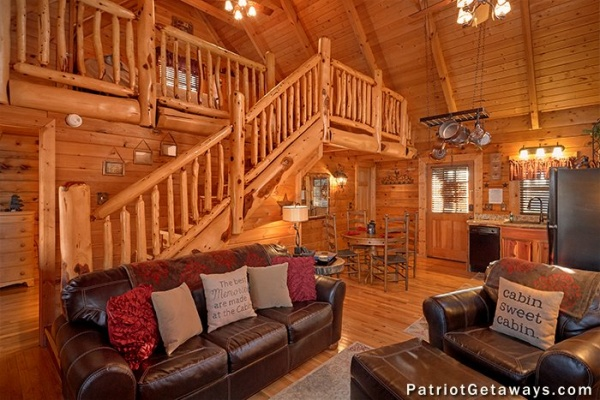 Living room with a sofa and loveseat at Elevation 1454, a 1-bedroom cabin rental located in Pigeon Forge