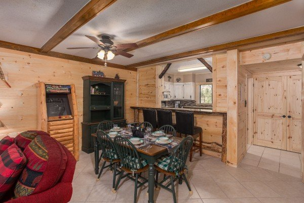 Dining space for six and breakfast bar for three at Under Ober, a 3 bedroom cabin rental located in Gatlinburg