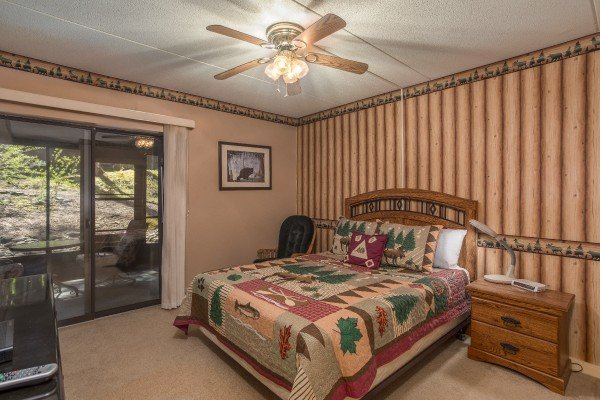 King bedroom with patio access at Under Ober, a 3 bedroom cabin rental located in Gatlinburg