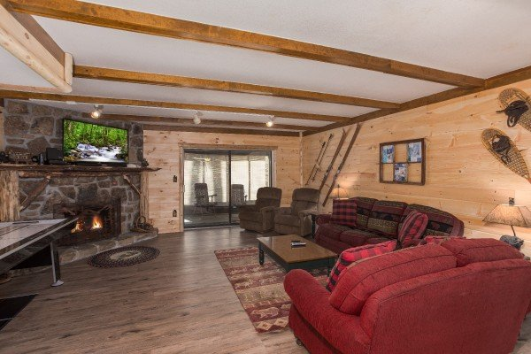 Living room with fireplace and TV at Under Ober, a 3 bedroom cabin rental located in Gatlinburg