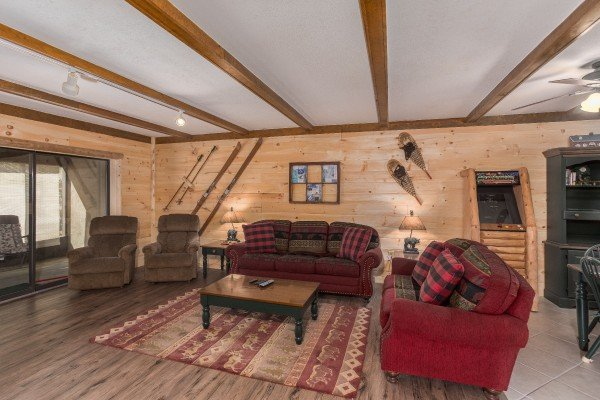 Two sofas and two chairs in the living room at Under Ober, a 3 bedroom cabin rental located in Gatlinburg
