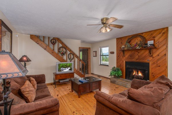 Fireplace with a wooded surround in the living room at Black Bear Ridge, a 3-bedroom cabin rental located in Pigeon Forge