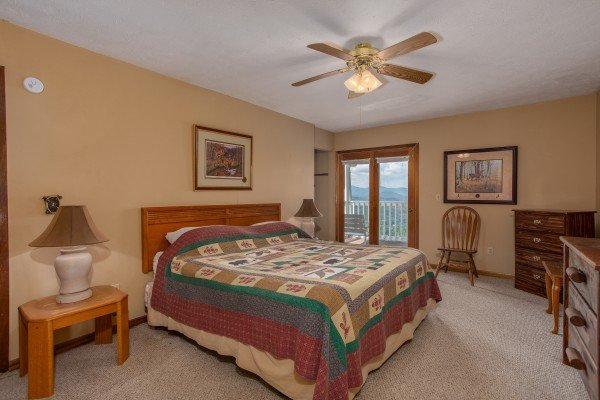 Bedroom with king-sized bed at Black Bear Ridge, a 3-bedroom cabin rental located in Pigeon Forge