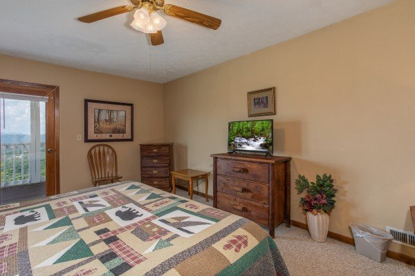 First bedroom with dressers and a television at Black Bear Ridge, a 3-bedroom cabin rental located in Pigeon Forge