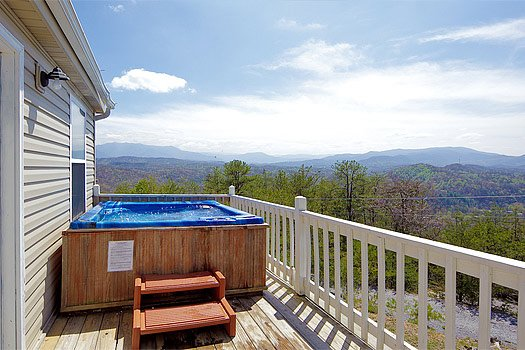 Hot tub on deck overlooking the Smoky Mountains at Black Bear Ridge, a 3-bedroom cabin rental located in Pigeon Forge