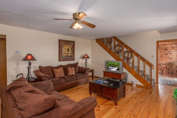 Living room with a sofa and loveseat at Black Bear Ridge, a 3-bedroom cabin rental located in Pigeon Forge