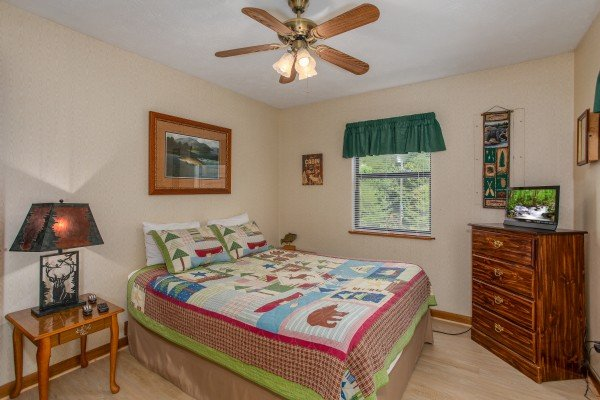 Bedroom with a dresser and television at Black Bear Ridge, a 3-bedroom cabin rental located in Pigeon Forge