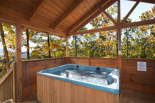 Covered hot tub at Mountain Memories, a 1 bedroom cabin rental located in Pigeon Forge