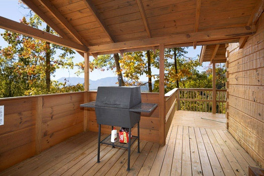 Deck with grill at Mountain Memories, a 1 bedroom cabin rental located in Pigeon Forge