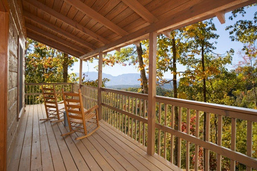 Deck with rocking chairs and Smoky Mountain view at Mountain Memories, a 1 bedroom cabin rental located in Pigeon Forge