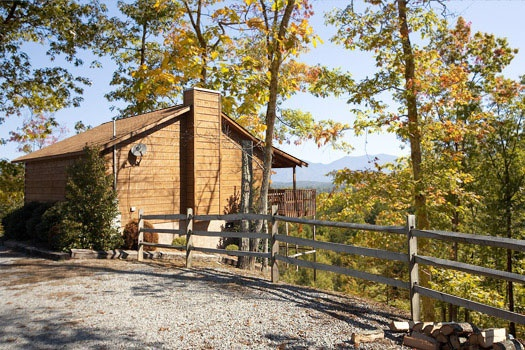 exterior view with parking area at mountain memories a 1 bedroom cabin rental located in pigeon forge