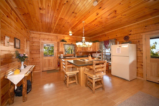 kitchen and dining area at mountain memories a 1 bedroom cabin rental located in pigeon forge