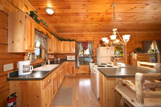 kitchen area at mountain memories a 1 bedroom cabin rental located in pigeon forge