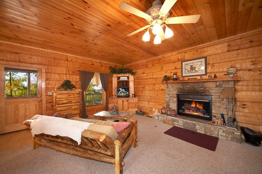 Living room with fireplace at Mountain Memories, a 1 bedroom cabin rental located in Pigeon Forge