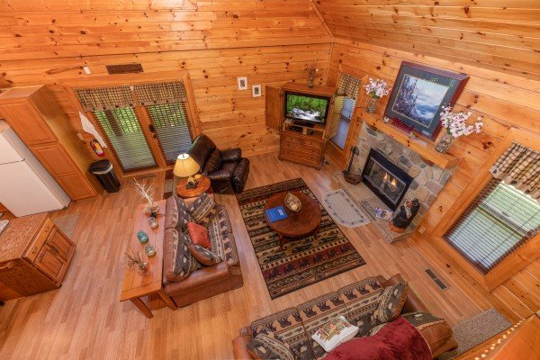 Looking down into the living room at Grand View, a 3 bedroom cabin rental located in Sevierville