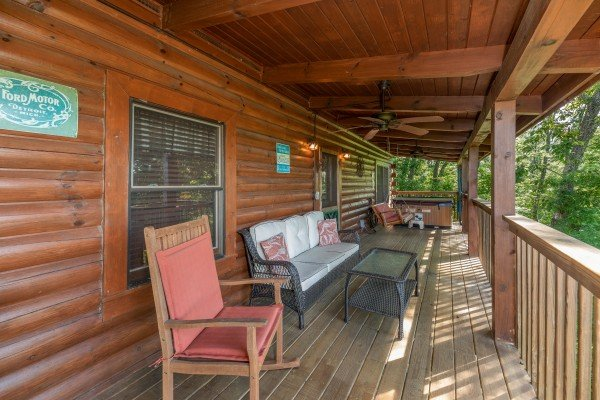 Plenty of seating on the covered deck at Grand View, a 3 bedroom cabin rental located in Sevierville