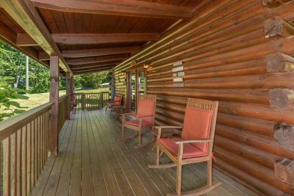 Rocking chairs on a covered deck at Grand View, a 3 bedroom cabin rental located in Sevierville