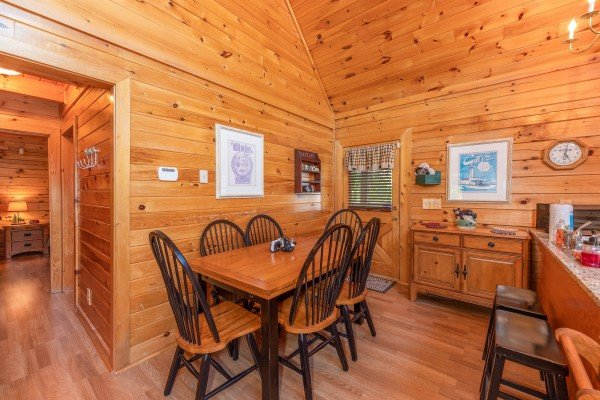 Dining room with seating for six at Grand View, a 3 bedroom cabin rental located in Sevierville