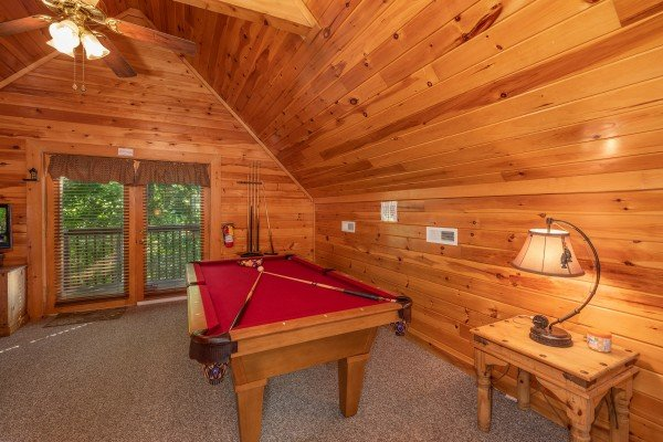 Red felt pool table in the loft at Grand View, a 3 bedroom cabin rental located in Sevierville