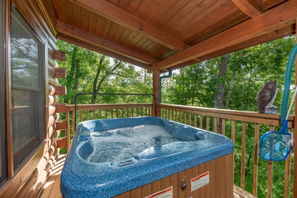 Hot tub on a covered deck at Grand View, a 3 bedroom cabin rental located in Sevierville