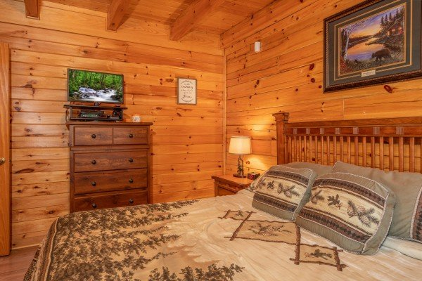 King bedroom with dresser and TV at Grand View, a 3 bedroom cabin rental located in Sevierville