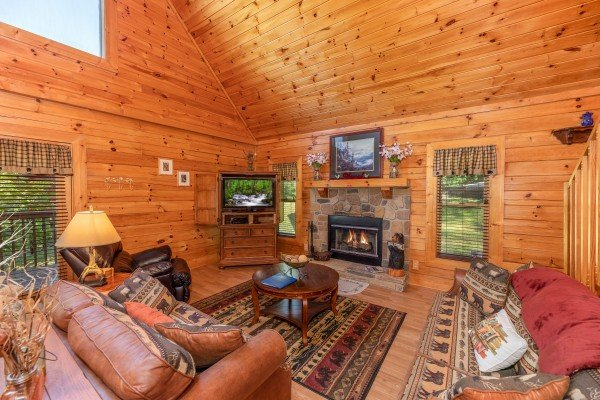 Living room with TV and fireplace at Grand View, a 3 bedroom cabin rental located in Sevierville