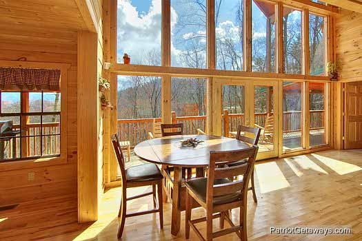 Seating for four around this bar height table in the living room at Alpine Pointe, a 5 bedroom cabin rental located in Gatlinburg