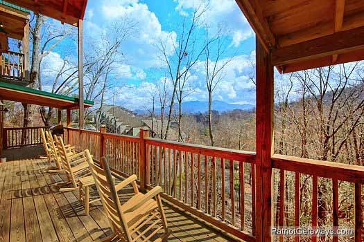 Four rocking chairs overlooking the Great Smoky Mountains at Alpine Pointe, a 5 bedroom cabin rental located in Gatlinburg