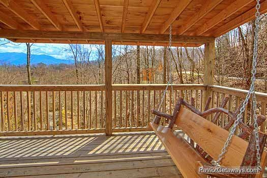 Deck swing on the main floor deck at Alpine Pointe, a 5 bedroom cabin rental located in Gatlinburg