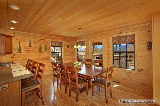 Dining table that seats eight at Alpine Pointe, a 5 bedroom cabin rental located in Gatlinburg