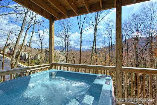 Hot tub on first floor deck at Alpine Pointe, a 5 bedroom cabin rental located in Gatlinburg