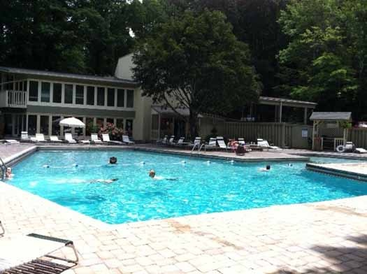 Enjoy the benefits of the resort pool area at Alpine Pointe, a 5 bedroom cabin rental located in Gatlinburg