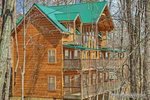 exterior view of multiple levels of decks along the back of property named alpine pointe a 5 bedroom cabin rental located in gatlinburg