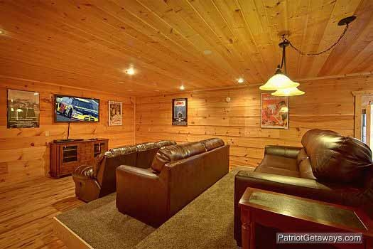 A large theater room with sofa stadium seating to enjoy your favorite at Alpine Pointe, a 5 bedroom cabin rental located in Gatlinburg