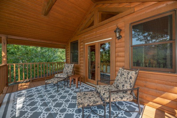 Chaise lounge chairs on a loft deck at Majestic Mountain, a 4 bedroom cabin rental located in Pigeon Forge