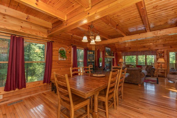 Dining table with seating for six at Majestic Mountain, a 4 bedroom cabin rental located in Pigeon Forge