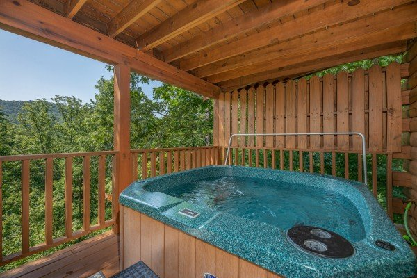 Wooded mountain views from the hot tub at Majestic Mountain, a 4 bedroom cabin rental located in Pigeon Forge