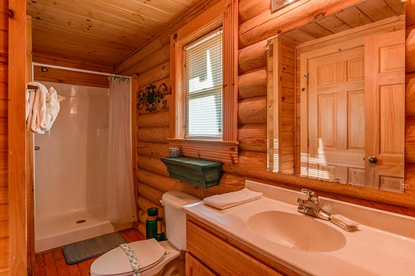 Bathroom with a shower stall at Kountry Lovin', a 2 bedroom cabin rental located in Pigeon Forge