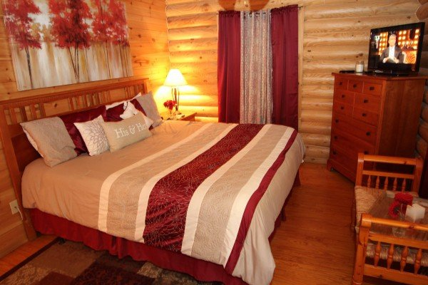 Bedroom with a TV and chest of drawers at Kountry Lovin', a 2 bedroom cabin rental located in Pigeon Forge