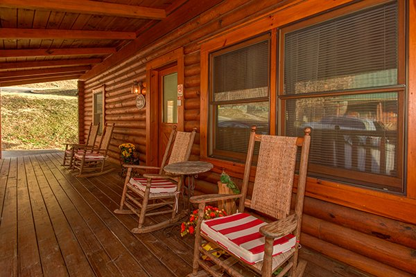 Front porch with rocking chairs at Kountry Lovin', a 2 bedroom cabin rental located in Pigeon Forge